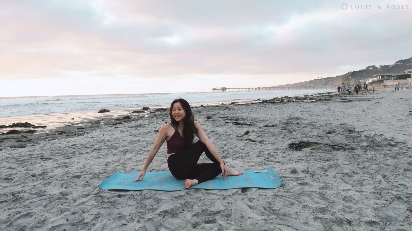 Doing half lord of the fishes pose at the beach to help alleviate back pain.